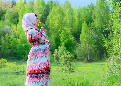 pregnant woman in a hijab in nature.jpg