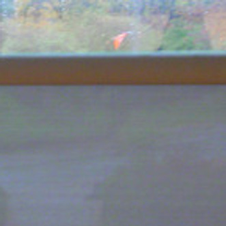 Three photos I took of an orange flag from a window in the Metropolitan Museum of Art on a rainy day