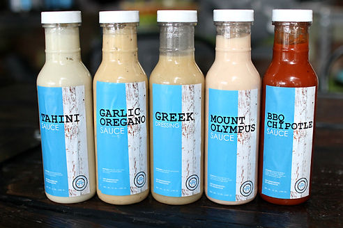 Merch page - image of salad dressings & sauces for sale