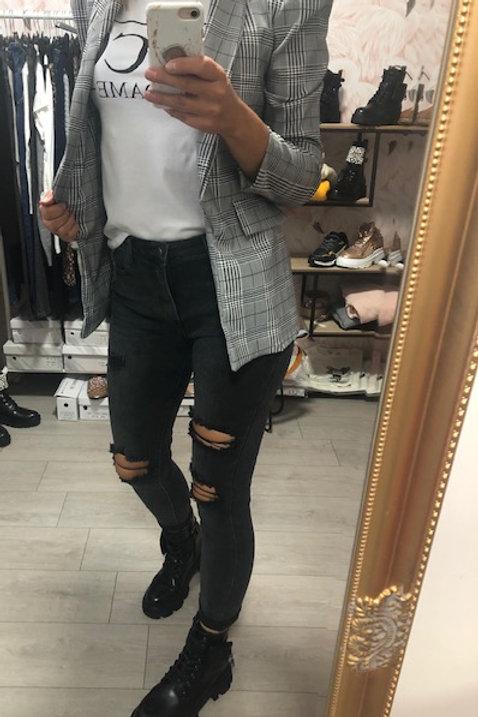 Zwarte jeans met scheuren