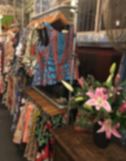 Display of brightly patterned apparel sold at Publisher Textiles