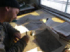 Owner sketching designs for traditonal hand printing