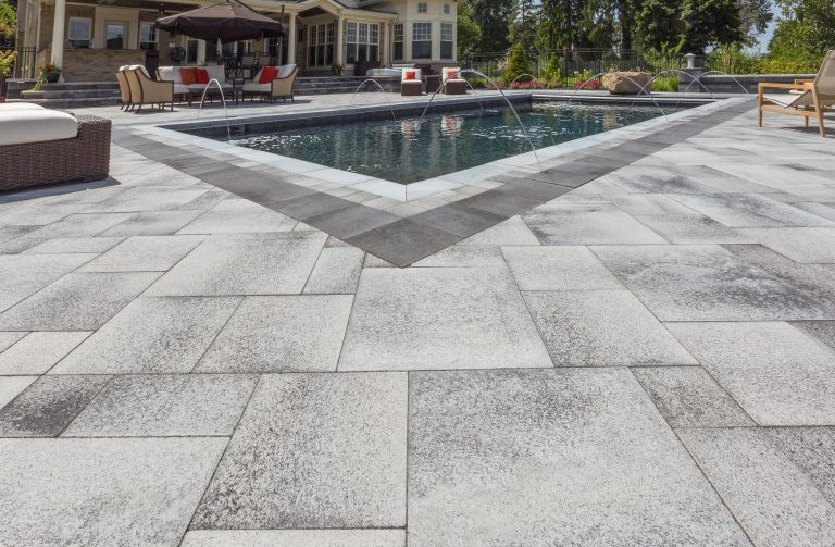Sandy Gray Colored Patio Pavers on The Lux pool