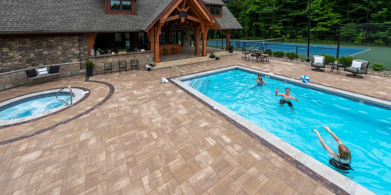 Beacon Hill pavers with red sailor Course on a The Lux pool