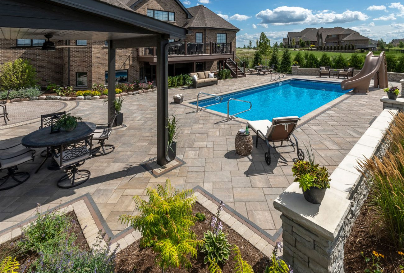 Unilock Beacon Hill Pavers with black and white edging on The Lux Pool