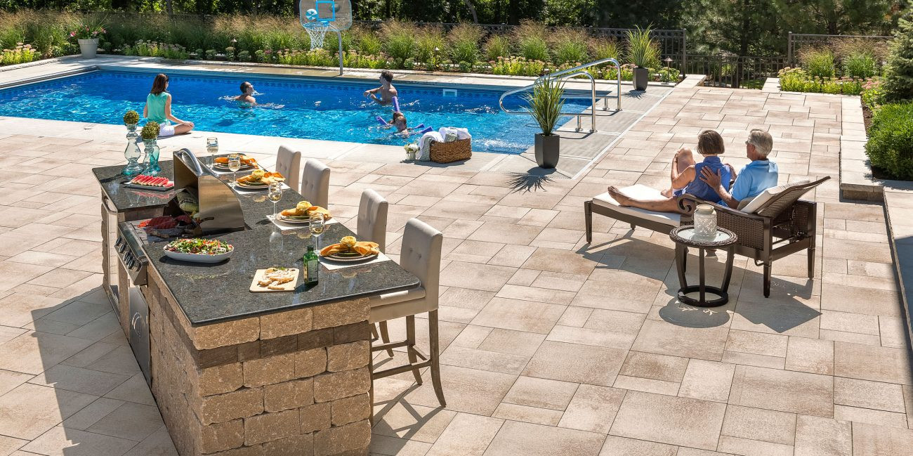 Brown pavers with The Lux Pool