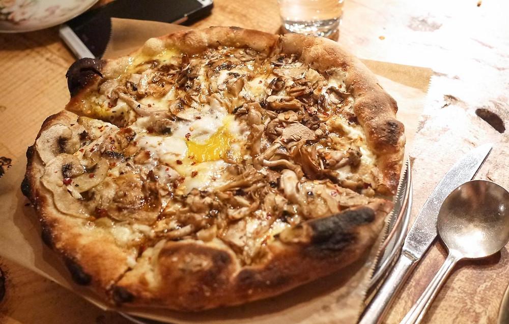 mushrooms, parmesan, oregano and farm egg pizza