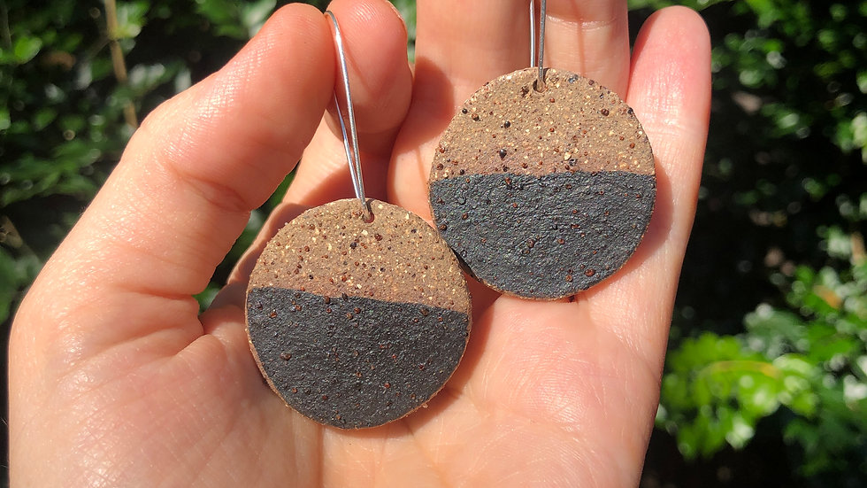 Speckled half black earrings