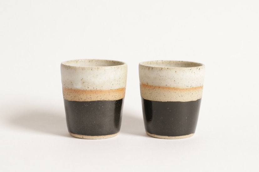 Black and white espresso cups