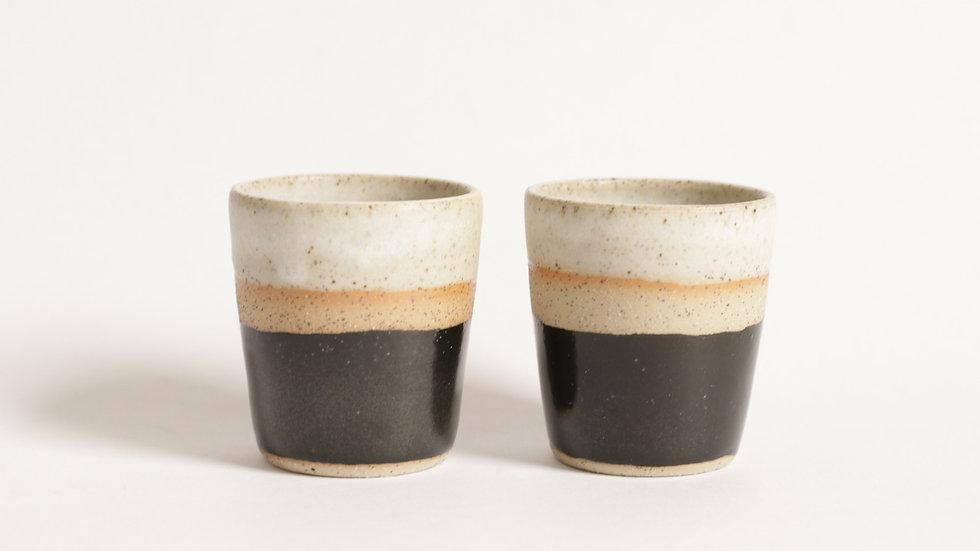 Black and white espresso cups