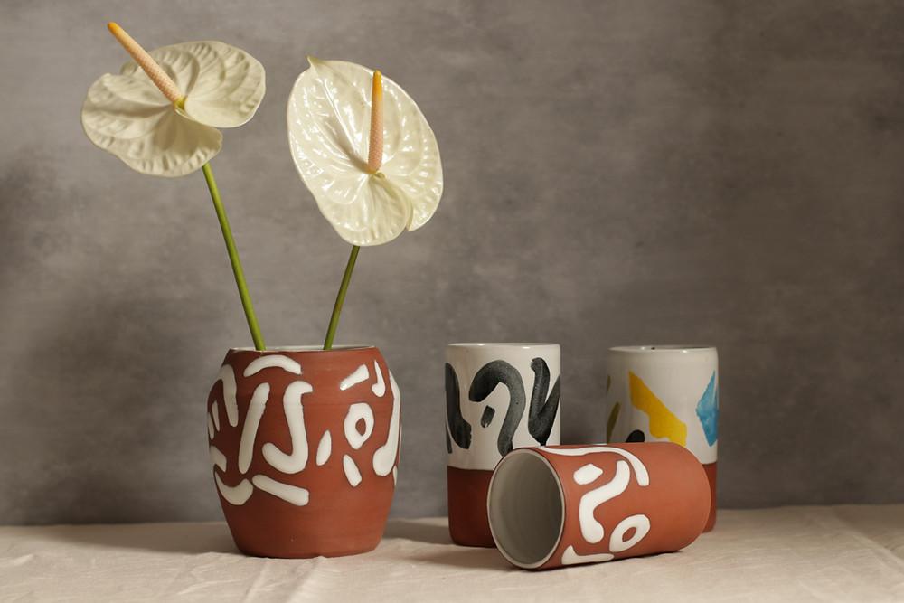 Terracotta and majolica glaze vessels by Blake Clay