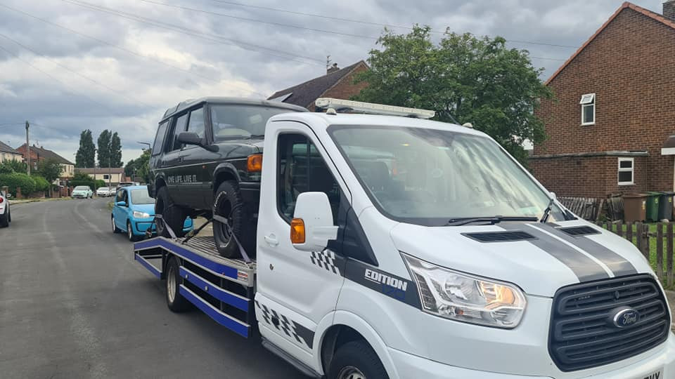 Recovery Truck with Land Rover Recovered