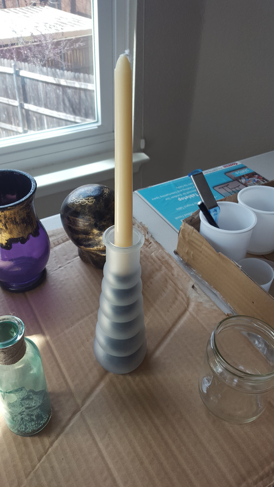 Next, I stuck a candle in it. I lit the candle and let it burn as I worked on other projects, but when I checked on it, the candle turned out to be magic! That candle burned almost completely down without dripping a single drop of wax ANYWHERE.