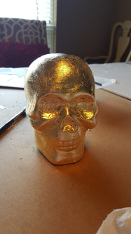 Completely covering the skull only took 5 sheets of gold leaf, and I ended up with a small bowl of scraps afterward