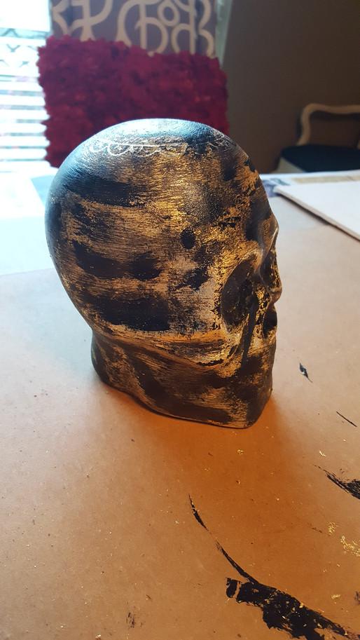 It's a Distressed Gold Leaf Skull