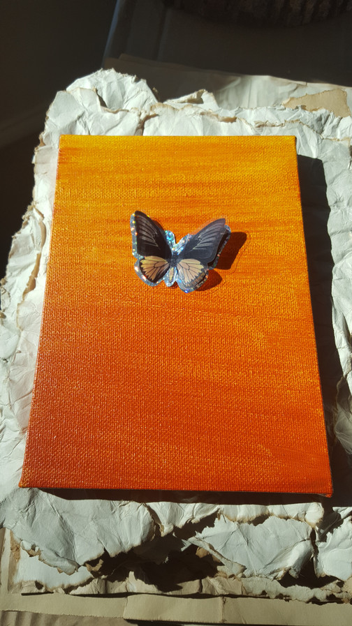 On the second canvas I placed a single butterfly sticker. The One.