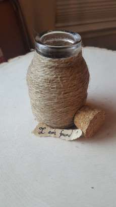 This jar was originally just a tiny glass jar, but I slathered it with glue and then wrapped it in twine.