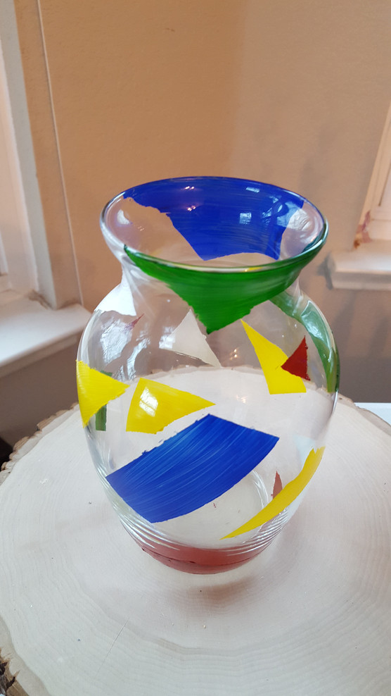 I basically taped off the jar at random angles, painted the in between, and peeled the tape off again! And then a lot of the paint wanted to peel off with the tape and it was a mess and I was very frustrated, but in the end it's kinda cute! I think it looks like a weird little fruitcake vase!