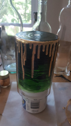 Once the paint was dry, I put on my gas mask (liquid gold is highly carcinogenic) and started dripping liquid gold down the sides of the vase. This was slow work, as I needed to build up the gold around the base slowly enough so that when it dripped it wouldn't go too far and over the edge, but not so slowly that the liquid gold would dry before it could drip.