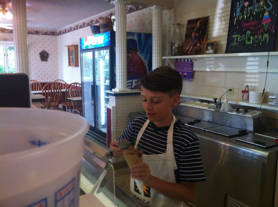 Even our younger ones scoop ice cream for a local charity