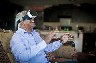 Senior man with VR headset on laughing