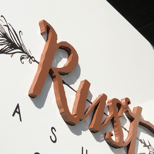 CNC Routed letters, painted and mounted to the face of the sign to accomplish a simple 3D look