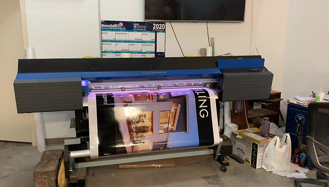 Our Roland TrueVIS VG2-540 printing a graphic for a 4' x 8' real estate sign