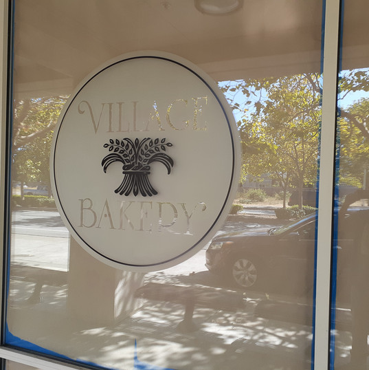 Frosted vinyl cut to shape with printed logo