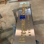 Stainless Steel sign with Laser Cut and Custom Painted Acrylic Letters