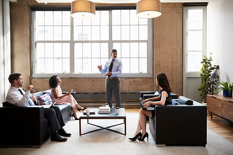 male-manager-presenting-at-informal-meet