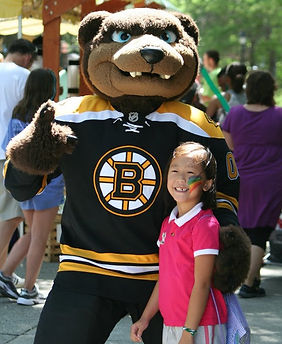 Bruins mascot with child
