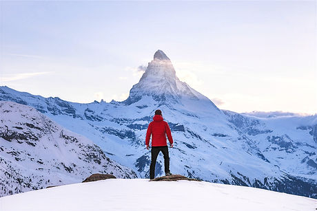 person in red hoodie standing on snowy mountain during daytime_edited.jpg