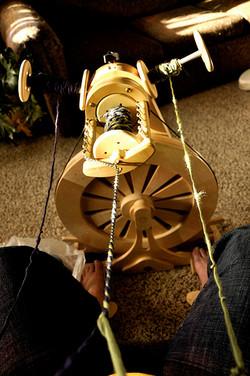 Gwynne at the Wheel Plying Yarn