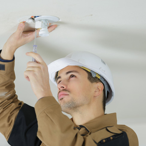 Get down from There! Why You Should Hire an Electrician to Install a New Light Fixture