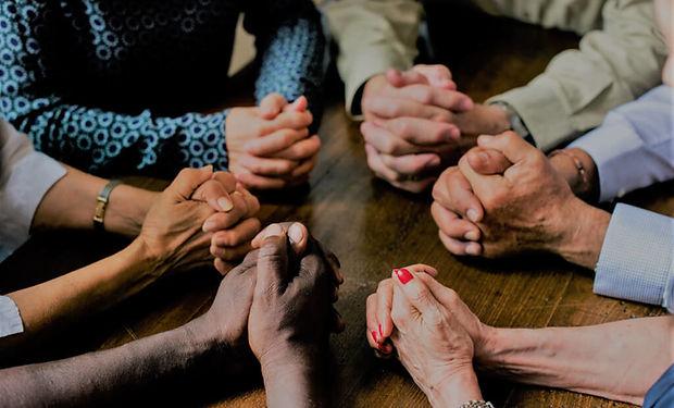Praying together diversity.jpg