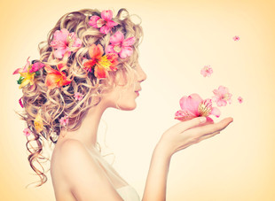 Beauty girl takes beautiful flowers in h