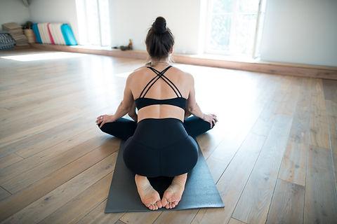 Two girls doing yoga teacher stretching