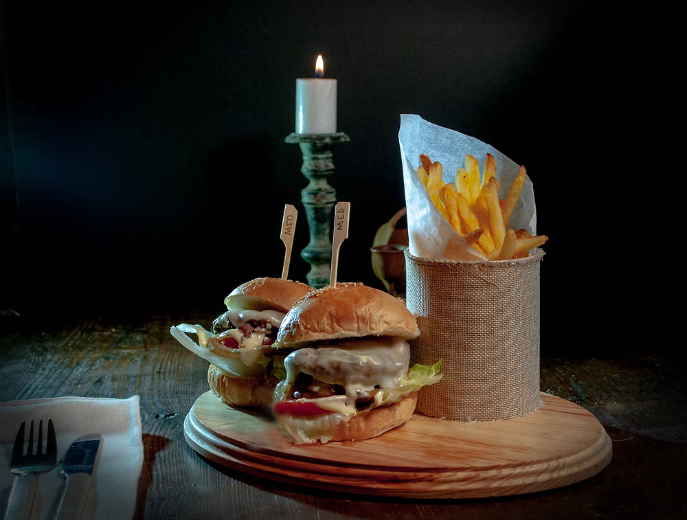 Slider / Burgers with fries on a cutting board