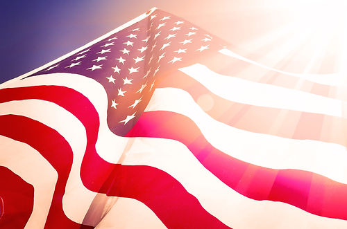 Flag of the USA with sunflare.jpg