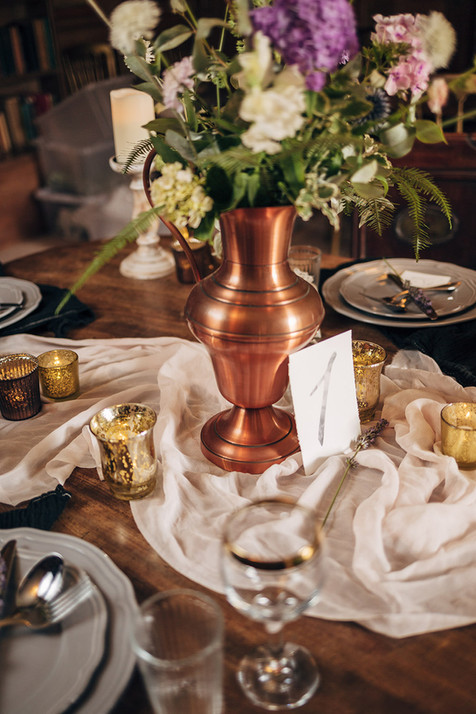 Tea Light Holders and Copper Vases at Nurstead Court, Kent