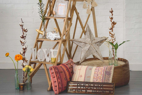 Vintage Wooden Lattice Ladder, Resin Skull, Table Plan Frames, LOVE sign, and Southwestern Star, Copper Pouffe, Boho Cushions, Gold and Bronze Tea Light Holders at The Winding House, Kent