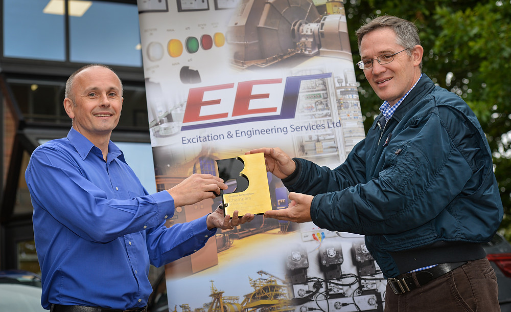 Douglas Cope, left, MD of Excitation Engineering Services, presented with his award by Martyn Richardson