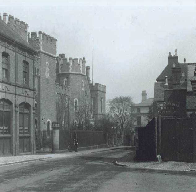 Photograph showing town hall of 1858 in centre next to the Old Police Buildings