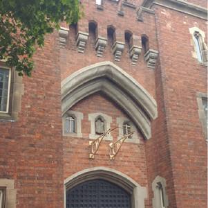 Tudor Gothic style police building.
