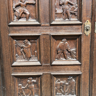 Door carvings were designed by architect GF Webb and executed by Charles Upton.