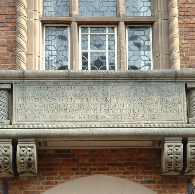 Stone balcony with memorial tablet