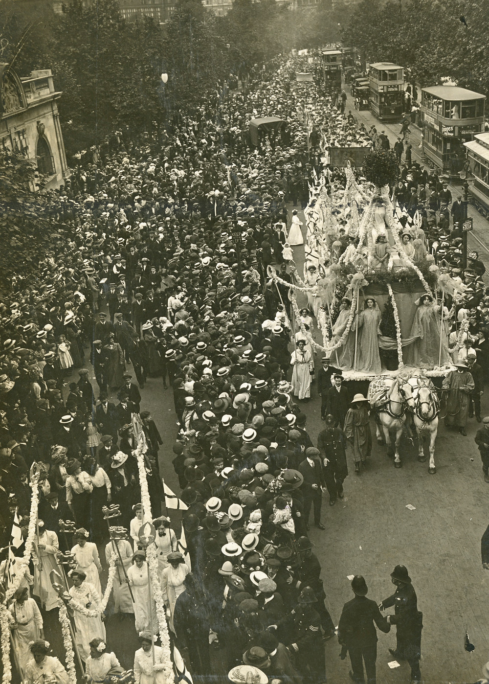 A street thronged with procession spectators. Source: The Women's Library (LSE)