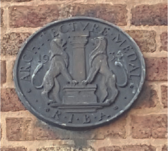 RIBA plaque situated on Priory Street elevation of Coroner's Court.
