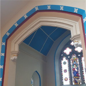 Arch leading to north chapel, adopting Perpendicular Gothic style