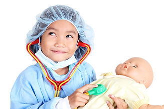 Little girl wearing doctor's operating g